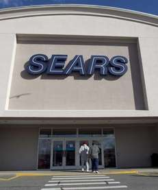 Shoppers enter a Sears department store location in