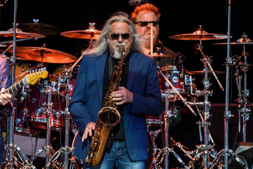 Bill Payne playing his sax during a Doobie