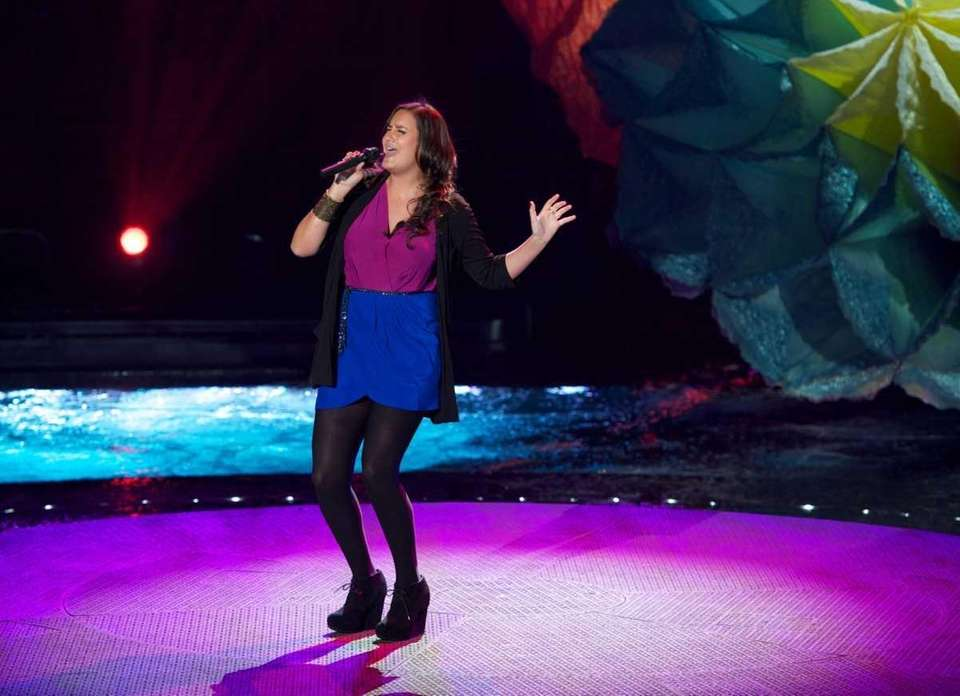 Contestant Jen Hirsch performs in front of the