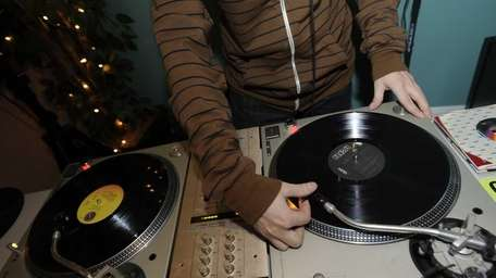 DJ Cash Lawrence spins records at Bring Your