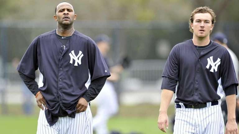 CC Sabathia, left, and Phil Hughes walking during