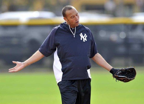 Yankees shortstop Derek Jeter gestures to infielder Eduardo