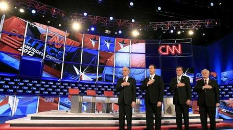Republican presidential candidates, from left, Ron Paul, Rick