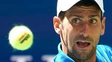 Novak Djokovic hits the ball against Roberto Carballes