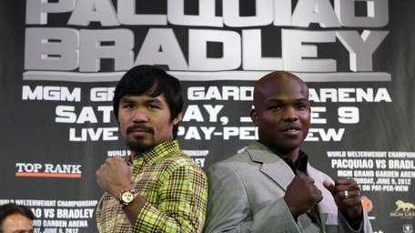 Manny Pacquiao, left, of the Philippines, and Timothy