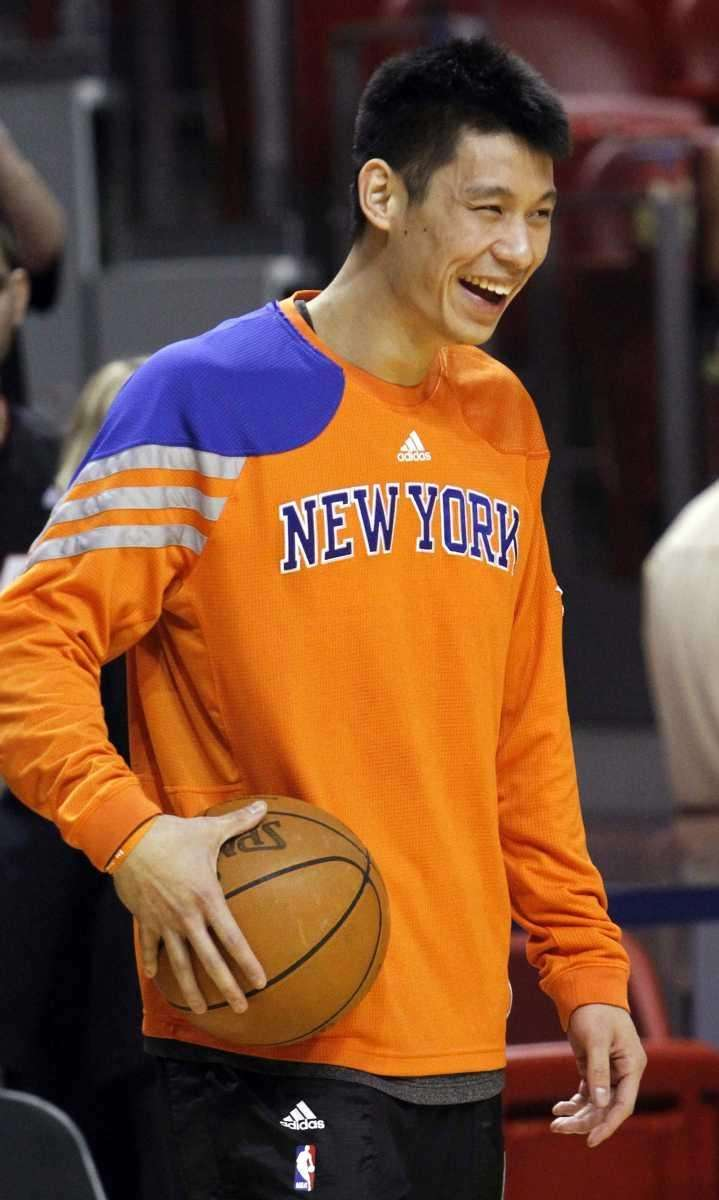 Knicks guard Jeremy Lin laughs before the start