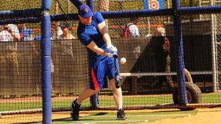 Mets outfielder Jason Bay takes a swing during