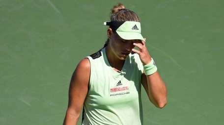 Angelique Kerber reacts during her women's singles first-round