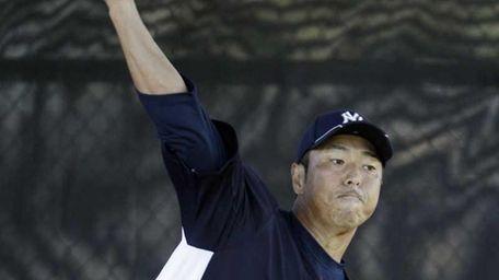 Yankees starting pitcher Hiroki Kuroda throws in the