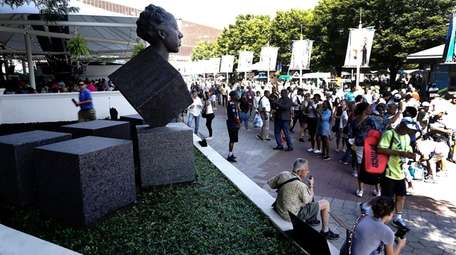 The sculpture of tennis great Althea GIbson outside