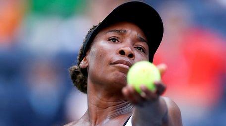 Venus Williams serves to Zheng Saisai during the