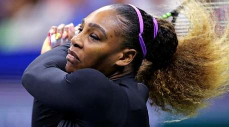Serena Williams returns to Maria Sharapova during the