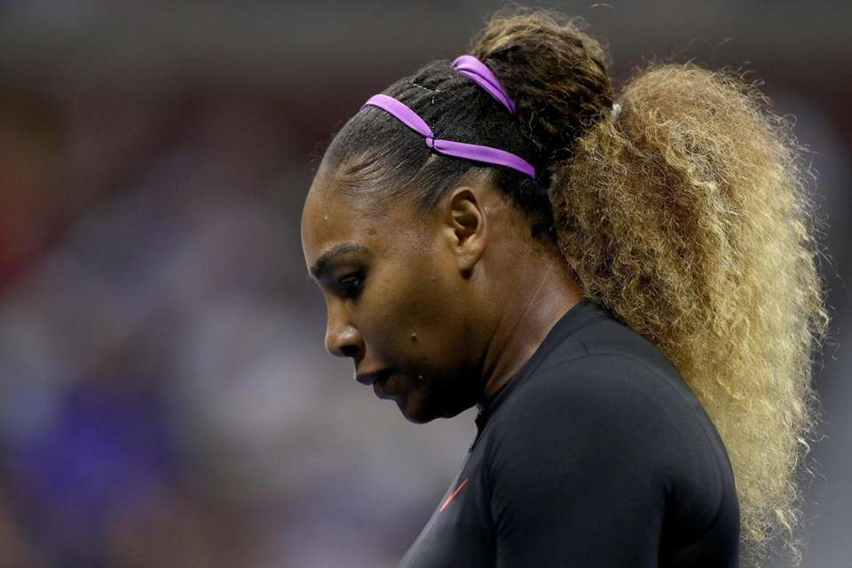 Serena Williams reacts during her women's singles first-round