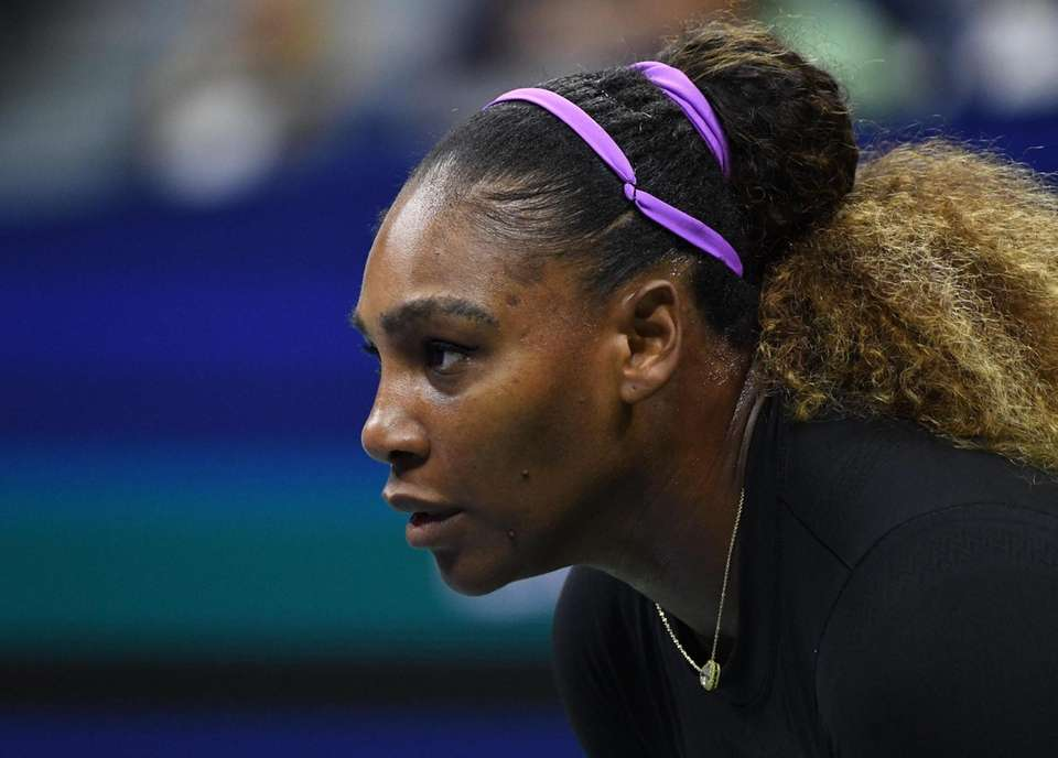 Serena Williams looks for a serve from Maria