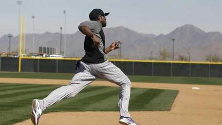 Colorado Rockies' Dexter Fowler rounds first base during