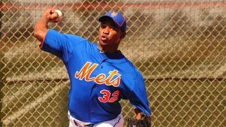 Mets pitcher Jenrry Mejia throws a bullpen session