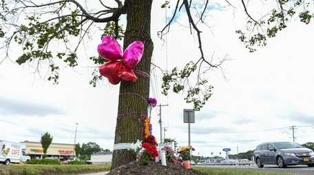 A makeshift memorial on westbound Nesconset Highway, just