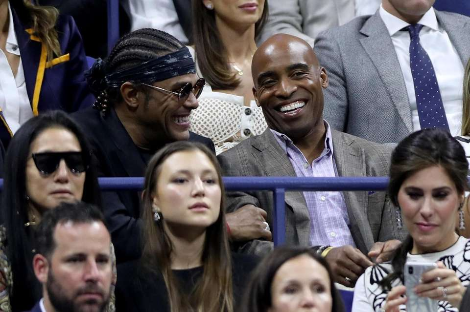 Maxwell, left, and Tiki Barber watch the Serena