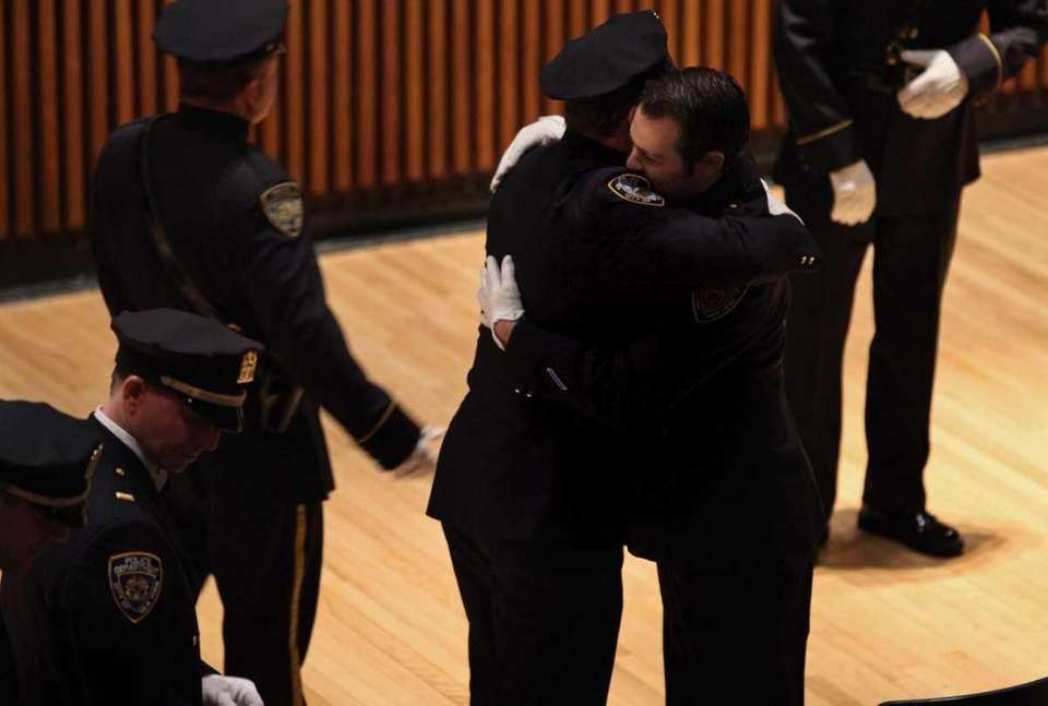 NYPD Det. Kevin Herlihy, embraces NYPD Det. Kevin
