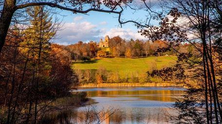 Colorful fall foliage frames Olana, a 250-acre landscape