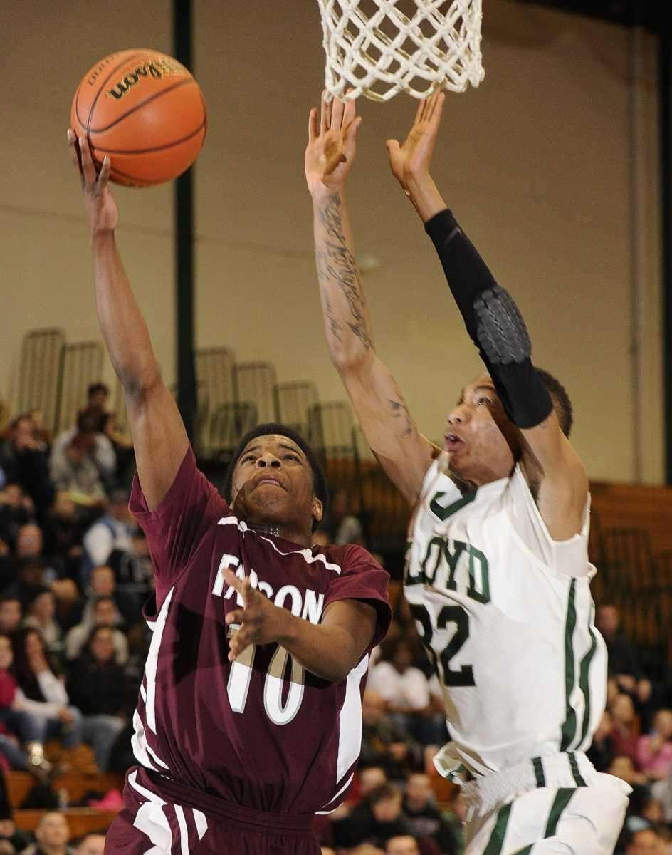 Deer Park's Kyle Bradford attempts a layup past