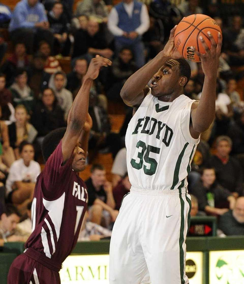 William Floyd's Anthony White shoots over a Deer