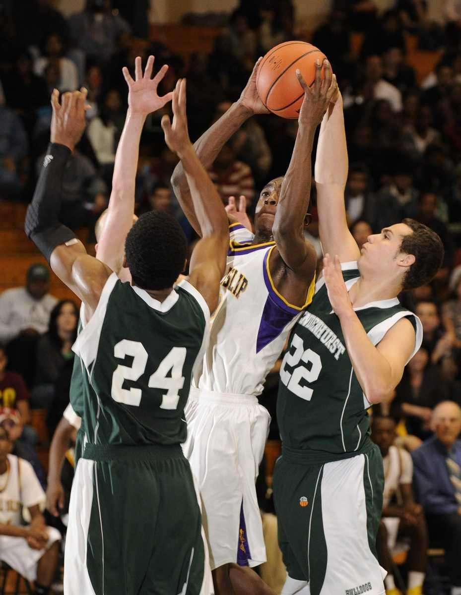 Central Islip's Tim McKenzie is pressured by Lindenhurst