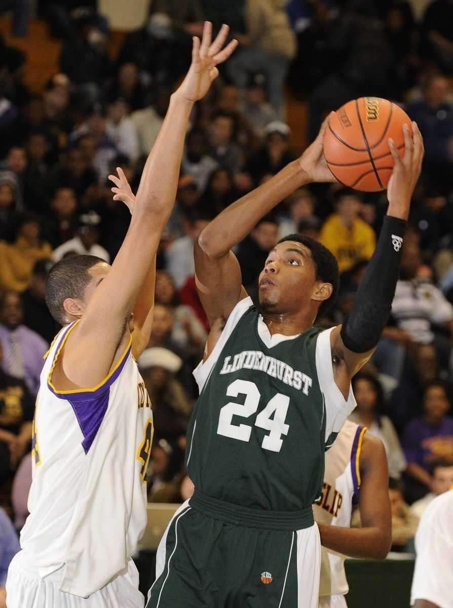 Lindenhurst's Stew Warren shoots past a Central Islip