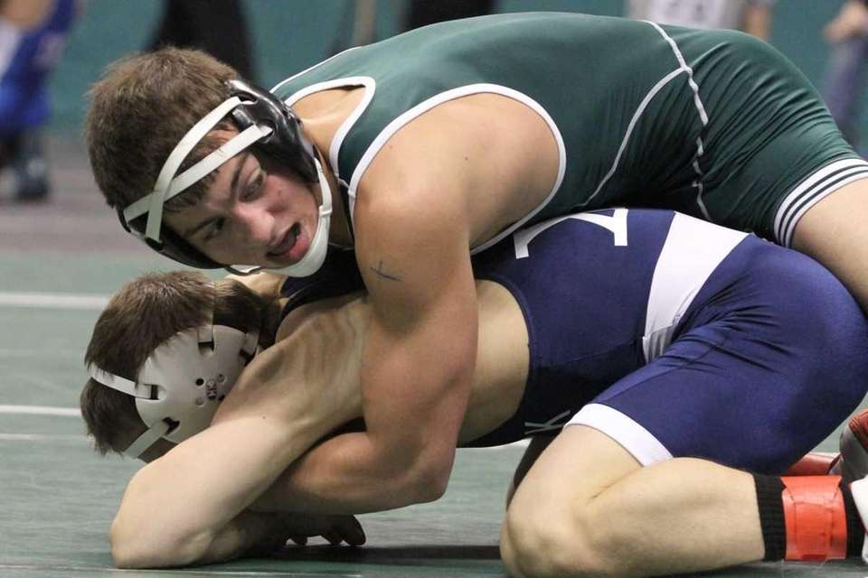 Roslyn's John Lanzilotti attempts to pin Sayville's Matt