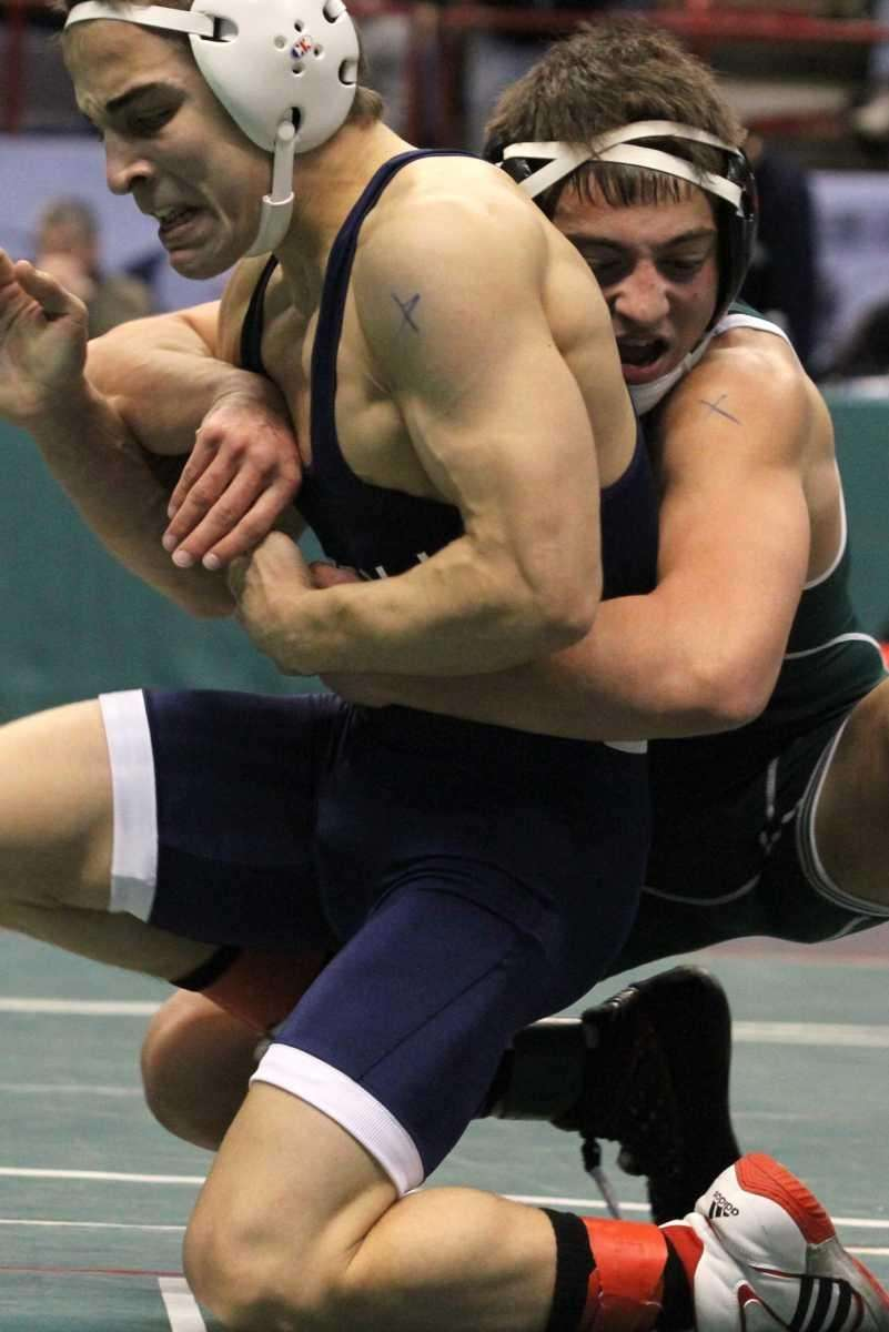 Roslyn's John Lanzilotti wraps up Sayville's Matt Leshinger