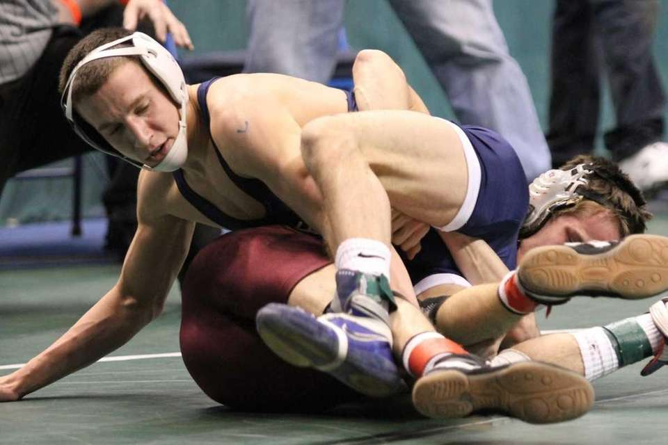 Eastport-South Manor's Maverick Passero battles Lansingburg's Drew Oligney.