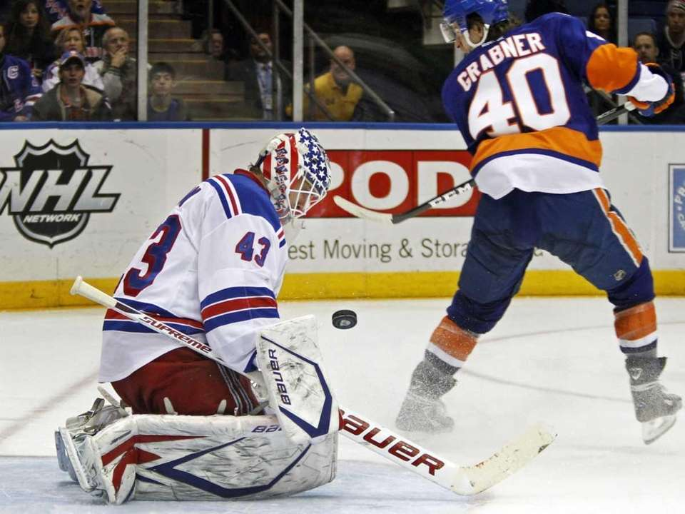 Rangers goalie Martin Biron blocks a shot by