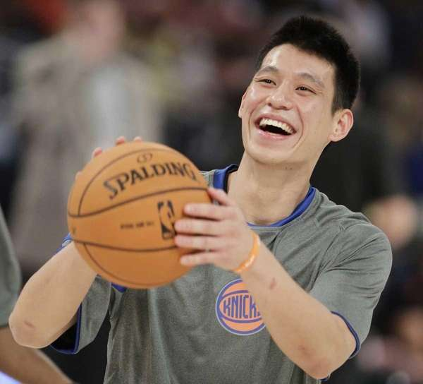 Knicks' Jeremy Lin laughs during warmups before the