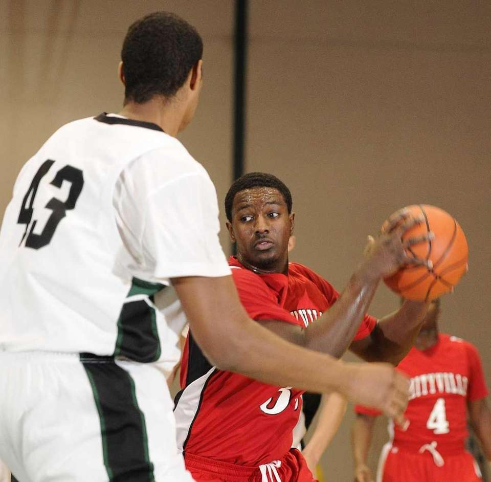 Amityville's DeJuhan Gray looks to pass against Harborfields.