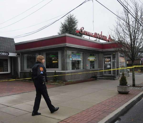 Police tape cordons off the Sayville Modern Diner