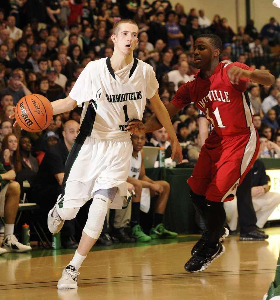 Harborfields' Lucas Woodhouse controls the ball as Amityville's