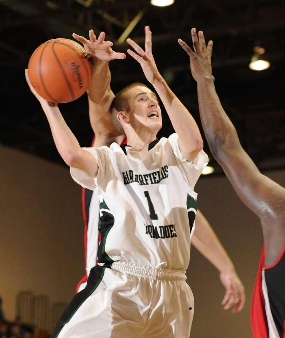 Harborfields' Lucas Woodhouse is fouled by Amityville's Billy