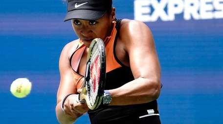 Naomi Osaka returns against Anna Blinkova during their