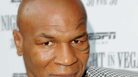 Former heavyweight boxing champion Mike Tyson and a