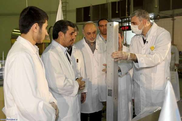 Iranian President Mahmoud Ahmadinejad (2nd L) and Foreign
