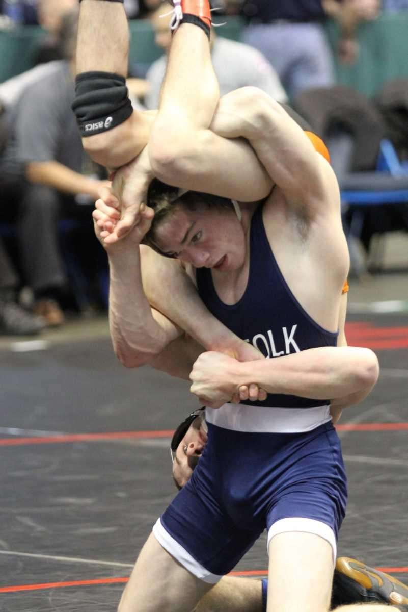 Hauppauge's Nick Mauriello flips his opponent during his