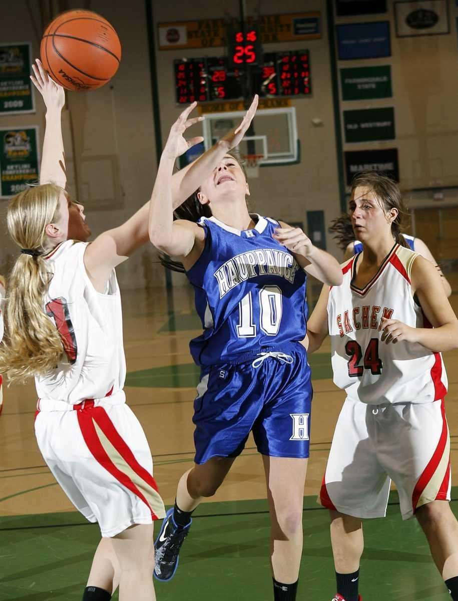 Hauppauge's Julie Williams (10) is fouled on a
