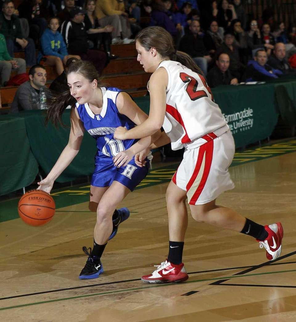 Hauppauge's Julie Williams (10) drives against Sachem East's