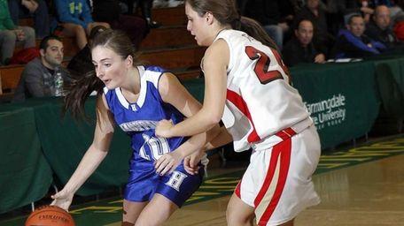 Hauppauge's Julie Williams (10) drives against Sachem East's