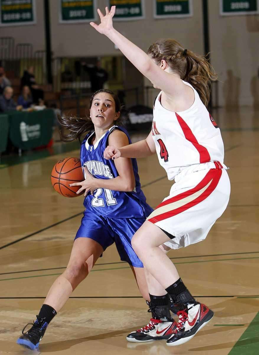 Hauppauge's Lindsay Alfano (21) draws the foul on