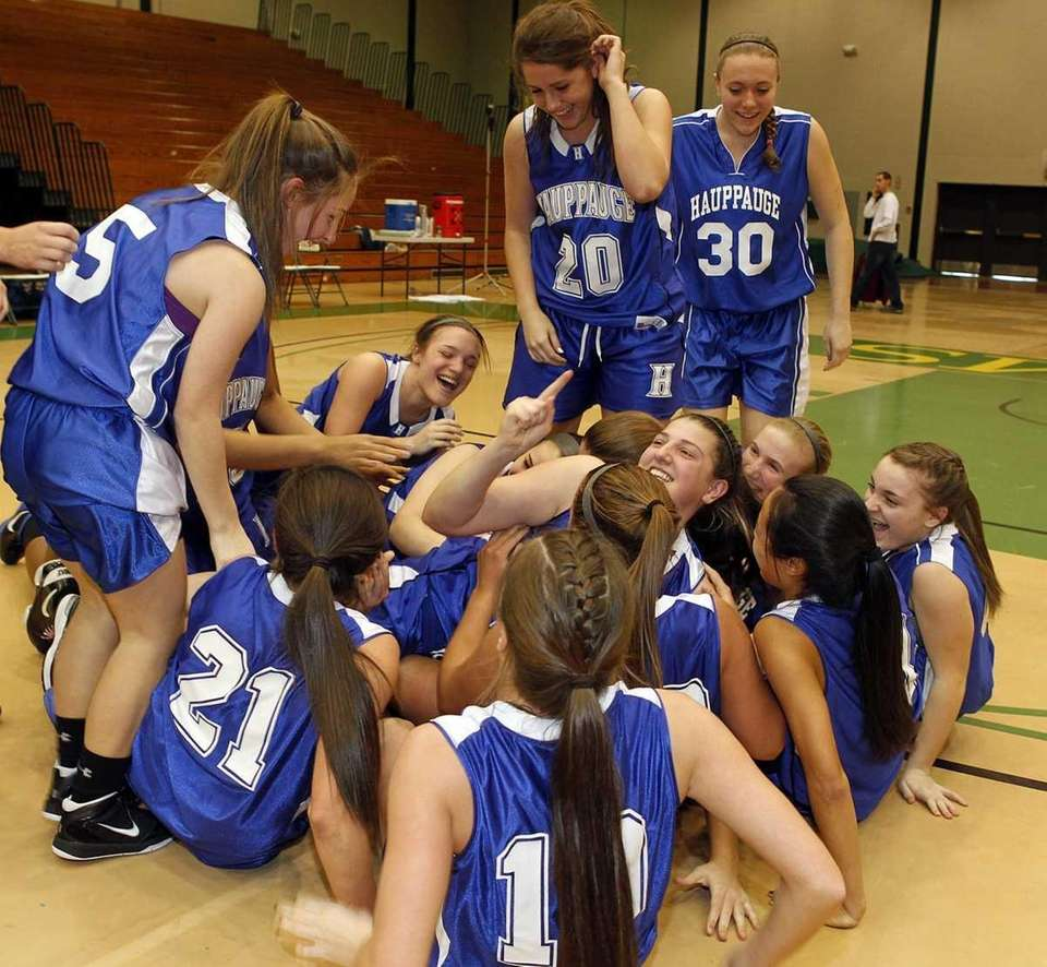 Hauppauge's girls basketball team celebrates their victory over