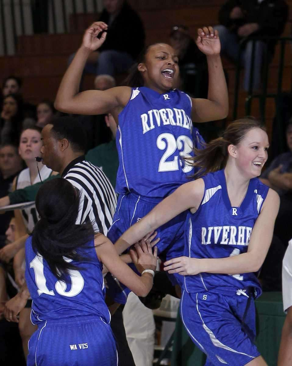 Riverhead's Shanice Allen, No. 23, celebrates after making