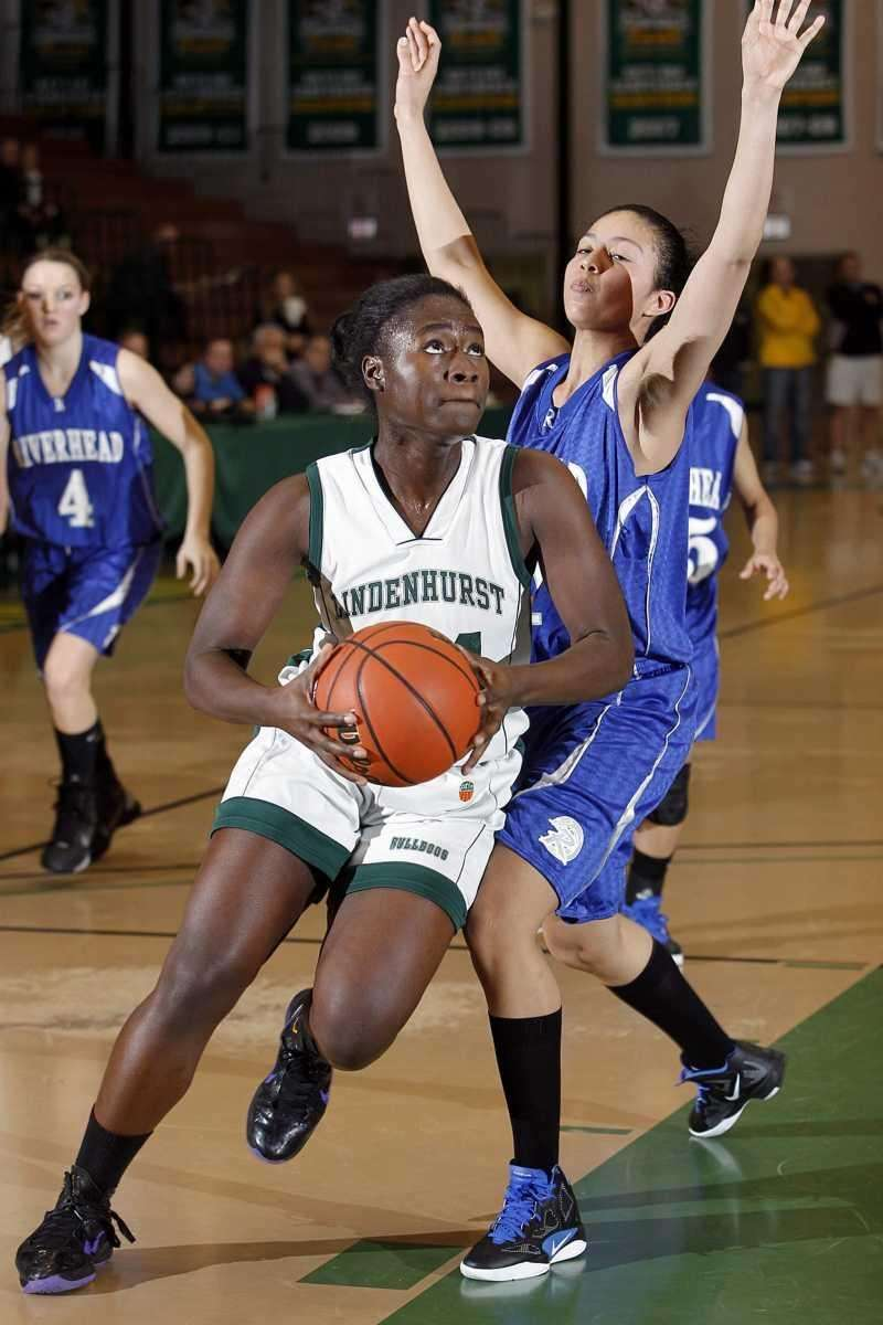 Lindenhurst's Naomi Oyakhilome (44) drive into the paint