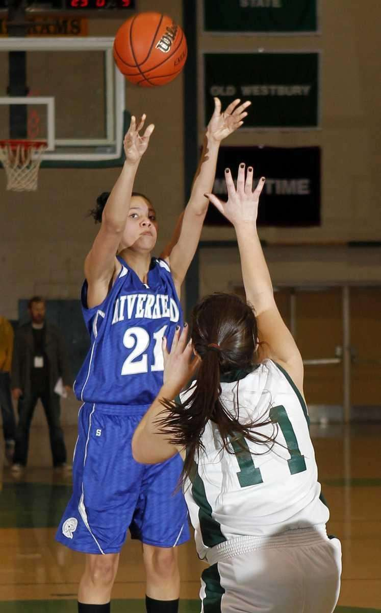 Riverhead's Kaila-Riane Nazario (21) with the jumper over