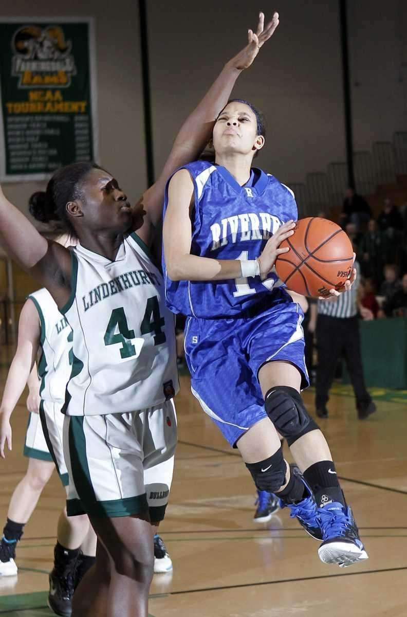 Riverhead's Jayln Brown (15) drives to the hoop